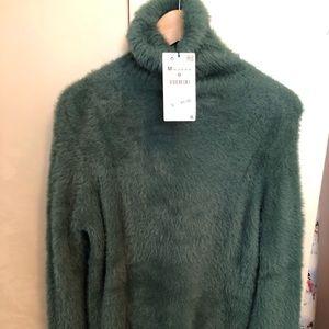 Turtleneck sweater. Light bluish-green